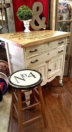 Painted dresser island with graphic from The Graphics Fairy and love the cool stool 3>