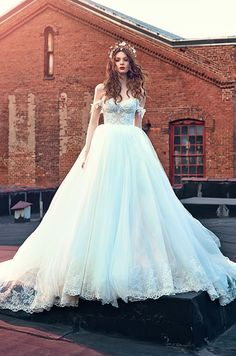 This off-shoulder light blue tulle ball gown wedding dress is just stunning! Click to view the full Galia Lahav Spring 2016 wedding dress collection.