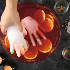 Serve a Halloween punch recipe guests will remember with the help of a little tonic water, a plastic glove, and black light. Simply fill a plastic glove with the tonic water and freeze. Serve your punch under black light and the hand will glow! Plat Halloween, Halloween Party Snacks, Halloween Desserts, Halloween Food For Party, Halloween Birthday, Halloween Kids, Halloween 2020, Healthy Halloween, Halloween Finger Foods