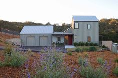 A modern farmhouse was designed by Gast Architects for a retired couple, nestled on rolling hills near the coast, just outside of Arroyo Grande, California. Modern Farmhouse Lighting, Modern Farmhouse Interiors, Modern Farmhouse Bathroom, Metal Building Homes, Metal Homes, Building A House, Barn House Plans, Shop House Plans, Metal Buildings