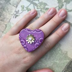 This lovely heart-shaped dark purple ring features a flowery pendant and beautiful texture. As much a pleasure to wear as to see! Mixed media ring by KerenOrHandmade on Etsy