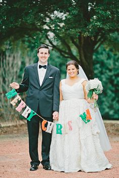 love this idea for a newlywed Christmas card - remember to bring the banner on your wedding day!