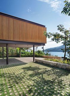 The CAA Residence is an attachment to a summer home in Angra dos Reis, a municipality of Rio de Janeiro, Brazil. Completed by Jacobsen Arquitetura, the addition serves as a guest wing, making room for a party. The expansion houses two new suites and an open plan living room and kitchen. Each space is polished …