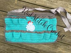 Gather your Eggs in Style!  This soft and cute egg collecting apron will safely hold a dozen eggs, leaving your hands free to tend to the hens. The bottom center pocket has space for Keyes, cell phone, or anything else. The tie is a ruffle ribbon which can be cut to any waist size. The cute little chicken was hand crocheted and sewn in place just to give this apron a little extra fun. Easy care acrylic yarn can be washed on delicate cycle and laid flat to dry.  There is an 8 pocket and 12…