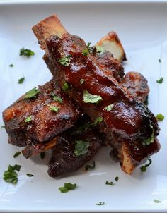Spicy Asian BBQ Ribs - These quick, oven baked ribs are smothered in a spicy sweet Asian sauce that will have you licking your fingers and reaching for more.