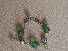 Frosted green glass beds with filigree silver balls. individual links for a bracelet with dangles