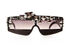 This eyewear is from the lower-priced line......Sunglasses hand beaded with Swarovski crystals, silver studs, and mini silver metal lightning bolts. This model is for both Men and Women. All Jaesyn Burke eyewear comes with a matching drawstring bag. Please allow 3-4 weeks for delivery.