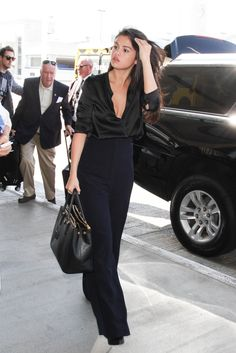 Slinky and silky airport goals from Selena Gomez in navy and black