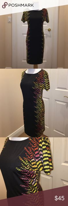 "Bebe Black Side colorful detail Dress Sz S Bebe Black Side colorful detail Dress Sz S, worn once, still in very good condition, short sleeve, mix of polyester and spandex, from center of dress measured down 31.5"", armpit to armpit about 15.5"", forgot retail will say $95 bebe Dresses"