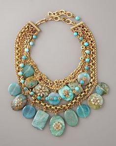 Dorje Designs - Huge turquoise, blue greens and seafoam colored nuggets from the Kingman Mine in Arizona, antique Moroccan amber, a bead from Papua New Guinea, and necklace.