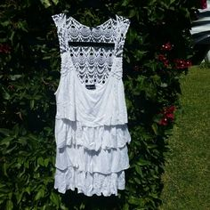 Wet seal white crochet top White crochet multi tier top.  Size tag is missing but fits size S/M Wet Seal Tops Tank Tops