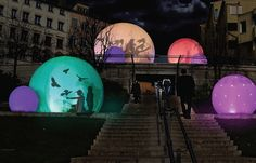 """At Lyon's Festival of Lights, Canadian collective Lucion Media created a magical-looking installation of """"bubbles"""" filled with shadows and light. Interactive Installation, Installation Art, Art Installations, Lumiere Lyon, Art Environnemental, Art Public, Art Et Design, Landscape Lighting, Light Art"""