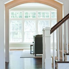 Architectural Columns Project Gallery - Pacific Columns, Inc. (tapered  columns over stone bases... encloses original posts, I think?)