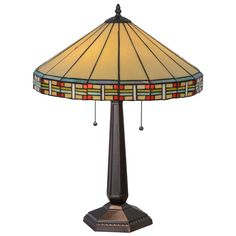 Large round art glass shade with red accents tops this craftsman lamp.