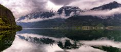 Calm Fjord Reflections The cloudy mountains reflect nicely in a calm Hardangerfjord. This is Norway! @tachyeonz