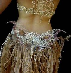 Bad link.....stain material with coffee or tea for this look or dye green or ???   Fairy skirt