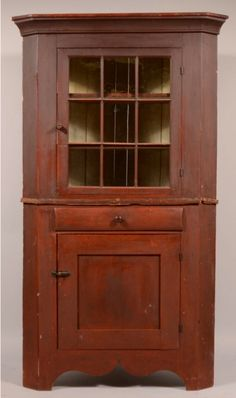 "Conestoga Auction Co. 6/1/13 lot 269. Est: $1K - 2K. Sold for $2400. Pennsylvania Country Federal Cherry Two Part Corner Cupboard with the Original Red Paint. Circa. 1830-1840. Cove molded cornice, single 9 pane glazed upper door, full width convex dovetailed drawer, lower single paneled door and serpentine cut out skirt. 79 1/2""h. 45""w. Condition: Good with minor wear and losses."