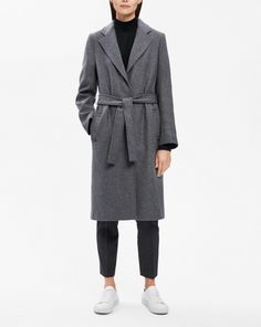 A timeless autumn investment made from traceable wool twill woven in Italy. Tailored belted coat, cut with narrow shoulders and slightly A-lined shape. Fully lined. <br><br> • Traceable mulesing-free wool from New Zealand<br> • Lightly A-line shaped<b