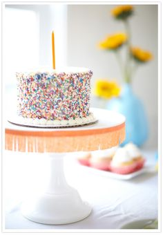 Add a little fringe to our Milk Glass Cake Stand for a festive vibe! | Birthday Fiesta as seen on 100LayerCake