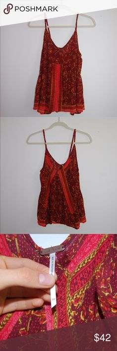 Free People Embroidered Crop tank top Size Small. Excellent Condition/ no flaws. 100% Rayon. Shoulder to Hem: 18.5 inches. Armpit to armpit: 17 inches. Free People Tops Tank Tops