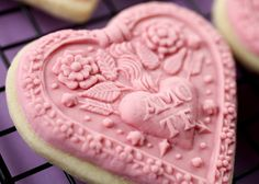 Cookie molds by Bakerella, used to mold fondant icing for an exquisite cookie.  Instructions & links to websites included.