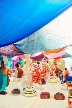 home made wedding cakes in colorful reception tent