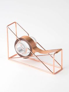 Give your office an authentic, sophisticated feel with the Copper Wire Tape Dispenser. With its copper wire construction that can fit infinite color palettes, this tape dispenser gives your desk a unique touch while keeping your stuff organized. Rose Gold Room Decor, Rose Gold Rooms, Gold Bedroom Decor, Cool School Supplies, Office Supplies, Gold Office, Cute Stationary, Tape Dispenser, Cute Room Decor