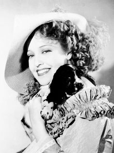 0 Jeanette MacDonald with puppy on her shouler