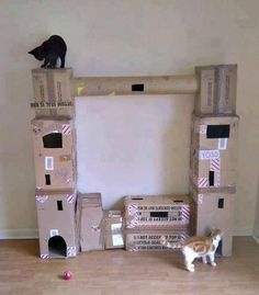 DIY kitty condo made from cardboard boxes; you could cover the boxes with wrapping paper to make them more aesthetically pleasing.