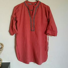 Adorable tunic Beautiful color tunic with foldable sleeves. One top button missing that hardly noticeable. Except that excellent condition overall . wforwomen  Tops Tunics