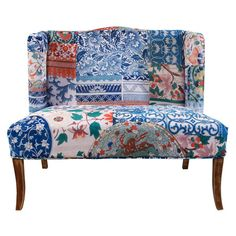 Wingbacked bench with paisley floral patchwork upholstery and saber legs. Product: BenchConstruction Material: Wood an...