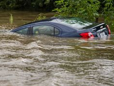 Flooding partially submerged a car in Youngsville,
