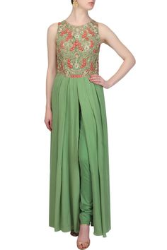 This green color kurta is in georgette fabric with zari and resham floral fully embroidered net bodice and slit in front centre. This green color kurta comes along with matching green fitted pants in