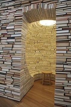 This entire page is nothing but creative things to do with books!  http://www.buzzfeed.com/peggy/what-to-do-with-all-those-books