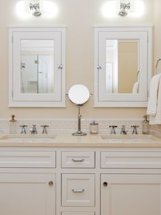 For hall bath. Double vanity, 2x mirrored medicine cabinets with outlets (prefer larger mirrors). Center drawers for blowdryer (with outlet) or hamper.