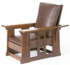 """LIMBERT Massive Morris chair with a single, broad slat cut-out with three squares, under each long and flat arm, a drop-in spring seat and loose back cushion newly recovered in dark brown leather. Original finish with light overcoat. Paper label under arm. 37 1/2"""" x 34 1/2"""" x 42 1/2"""" some nicks and scratches to tops of arms."""