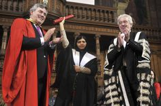 Malala Yousafzai (center), the Pakistani girl shot by the Taliban after campaigning for girls' education, stands between British former prime minister Gordon Brown (left) and university Principal Professor Timothy O'Shea as she receives an honorary master's degree from the University of Edinburgh during the first Global Citizenship Commission meeting on Oct. 19. IMAGE: ANDY BUCHANAN/AFP/GETTY IMAGES