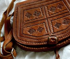 A beautifully worn, vintage, Moroccan/Mexican style, embossed-leather shoulder bag. Its a lovely amber-tinted brown tone and super soft to the