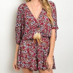 """✨NEW✨Wine Floral Daisy Crochet Romper V-neck, short sleeve romper with an open crochet back detail and blue and pink small daisy floral print. Bust of small measures approx 36"""" and length approx 33"""" Leather and Sequins Pants Jumpsuits & Rompers"""