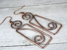 """♦ Hammered Copper Wire Earrings, Tribal Antiqued Copper Wire Earrings, BOHO Rustic Copper Wire Earrings. Copper Swirl and rectangle design earrings made from pure 14 Gauge copper wire. These earrings are oxidized for a warm, aged or antiqued look and hand polished for contrast. Simple light weight everyday wear copper earrings. ♦ Earrings measure 2-1/4"""" long to ear wires x 3/4 wide. ♦ # 001 See Customer feedback: ♥ (Example) ♦ Very happy with my purchase. Great service! Would definitely…"""