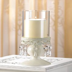 """A lacy base and dazzling crystals add old-world charm to this elegant centerpiece. A romantic reminder of gentle bygone days, filling your home with nostalgic candlelight! Weight 0.6 lb. 4"""" diameter x 10 1/4"""" high; base is 5 1/4"""" high. Iron and glass. Candle not included."""