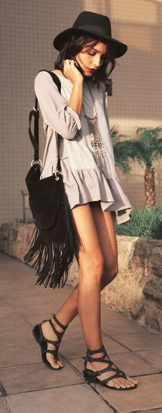 I love the fringed bag and those cool strapped black leather sandals!!!