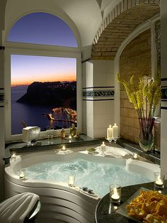 A relaxing bath with a beautiful view and scented candles around for a stress-free day