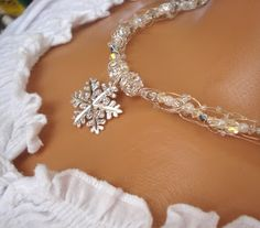 Example supplies. Beautiful snowflake necklace. Wire Knit Necklace Designs for Winter Brides - The Beading Gem's Journal