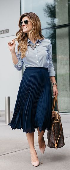 pleated midi navy skirt, a striped blue shirt, blush shoes