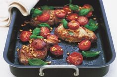 Roast pork steaks with tomatoes and pine nuts