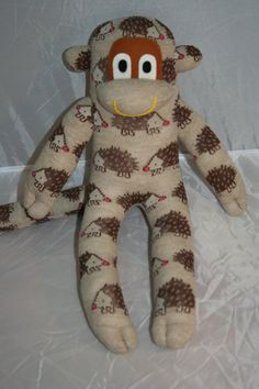 Check out this item in my Etsy shop https://www.etsy.com/listing/201952860/sock-monkey-plush-with-hedgehogs