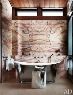 The master bath of a Colorado home conceived by Studio Sofield.