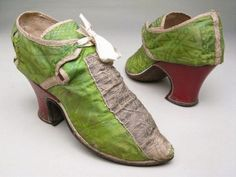Green silk damask shoes over fawn kid bound with cream silk ribbon. Heels covered with red leather. Fronts, with central figured silver ribbon trimming. Side sections pierced with hole for ties at pointed top front corner. 18th Century Clothing, 18th Century Fashion, 19th Century, Vintage Boots, Vintage Outfits, Green Shoes, Crazy Shoes, Historical Clothing, Leather Heels