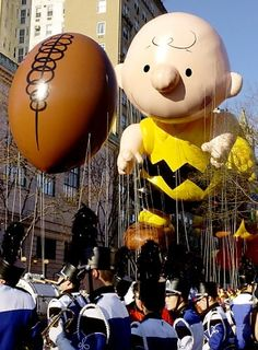 Macy's Thanksgiving Day parade balloons: Through the decades - NY Daily News;  Charlie Brown chasing the football!